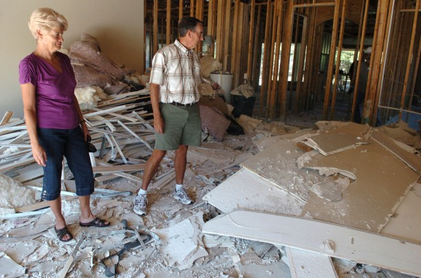 Joanne and Jim Haseltine in 2010. The Haseltines are replacing the drywall in their River Wilderness home at their own expense, because their builder has refused to do anything about the problem.