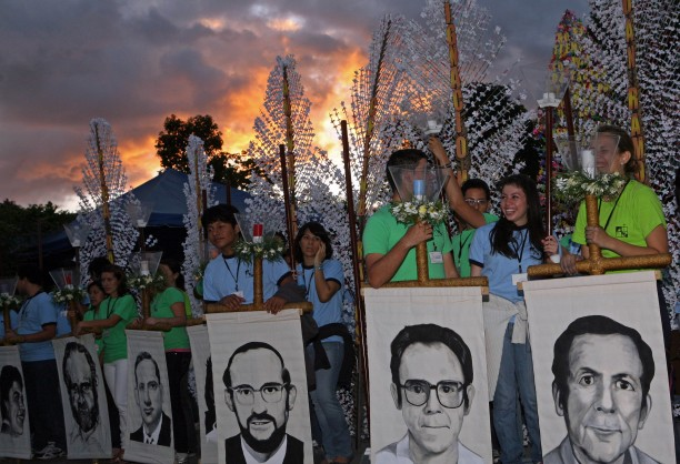 Students of the Central American University Jose Simeon Canas hold portraits of the six Jesuit priests from Spain, that were killed by the Salvadoran Army during the civil war in 1989, as they participate in a tribute ceremony in the 21st anniversary of their execution in San Salvador, El Salvador, Saturday Nov. 13, 2010.