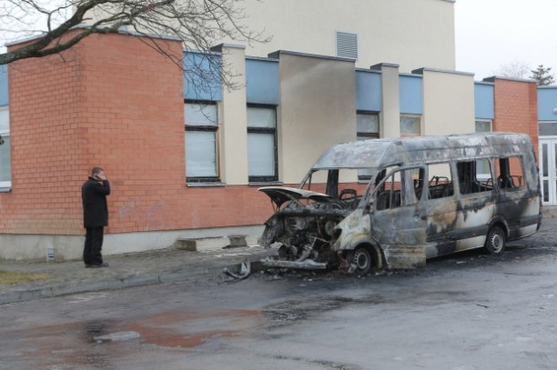 The battle for bodies in Lithuania has grown violent. Here, a hearse that was blown up.