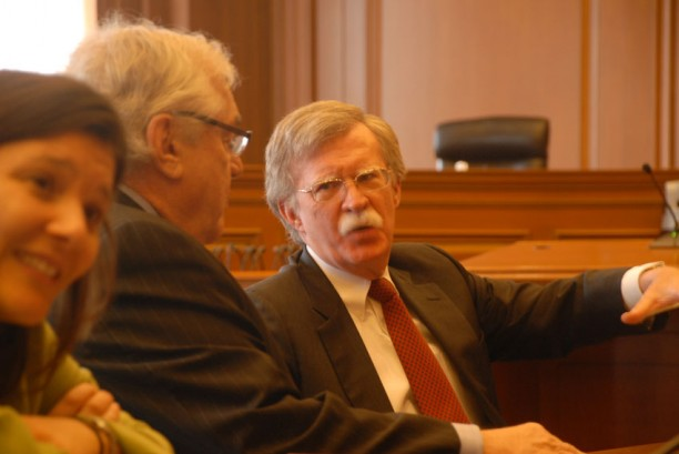 John Bolton, who advocated for the U.S. invasion of Iraq during the Bush administration, was in court Monday defending Siemens and its subsidiaries, accused of bribing Saddam Hussein. Here, Bolton chats with Robert W. Bennett, who represented former president Bill Clinton during the Monica Lewinsky Affair and was in court representing BNP Paribas in the same case.
