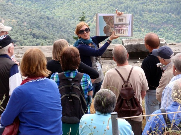 Petra Tsaousidou, a traditionally-trained tourist guide, speaking to tourists in Delphi.