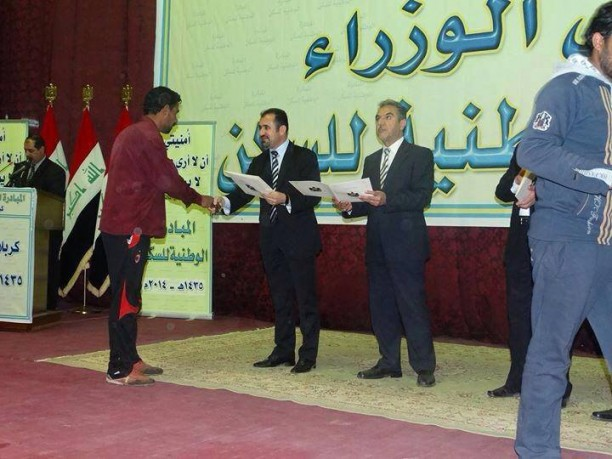Hussein al-Maliki handing out land deeds before parliamentary elections last spring.